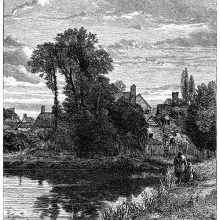 View of a large pond with a village behind it, partly hidden by a clump of trees