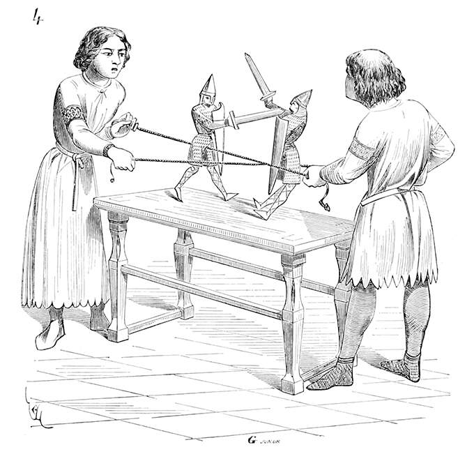 Two boys playing with puppets