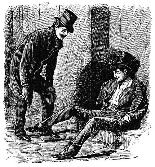 A drunk man is sitting on the pavement as his laughing friend leans toward him