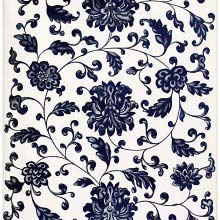 Pattern of blue flowers and leaves against a white background