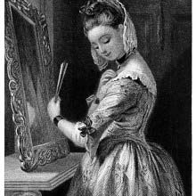 A young woman stands before a mirror and straightens the collar of her dress