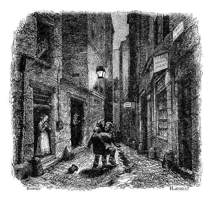 Two men are fighting in a narrow street at night