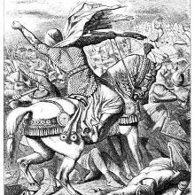 A man on horseback is taking part in a battle and waving his fist