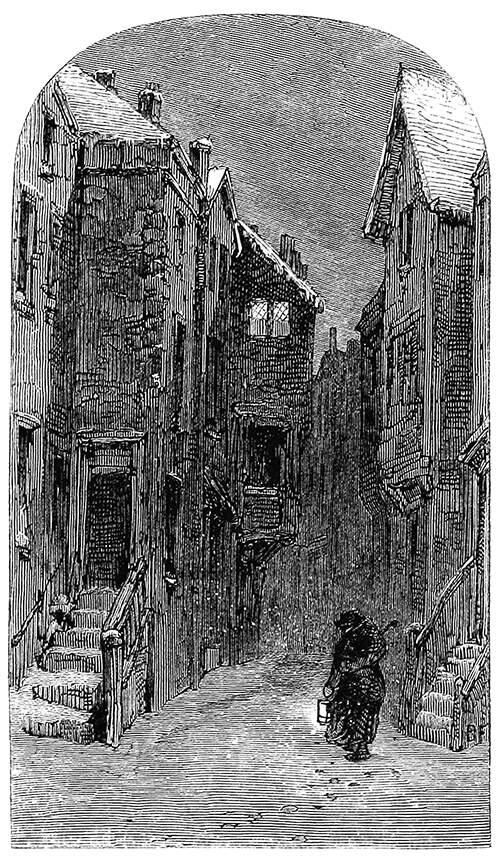 A man walks in the snow carrying a lantern along a narrow street