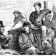 A man plays the bandoneon for a small group sitting at the rear of a boat