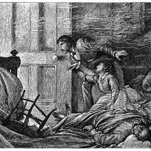 A man moves toward the door of a bedroom as a woman tries to cling to him