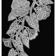 Lace design showing convolvulus flowers, leaves, and tendrils