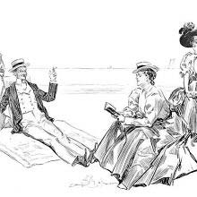 A man is lounging on a beach in the company of fairly indifferent women