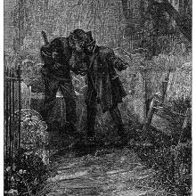 Two men stand whispering to each other in a graveyard