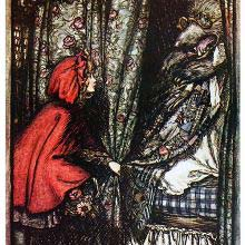 Little Red Riding Hood pulls the curtain of the bed in which the wolf is lying