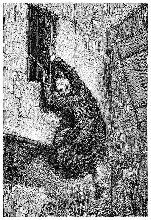A man escaping through a window is about to let himself drop to the ground.