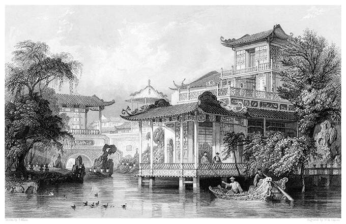 View of a opulent house built on piles on a canal near Guangzhou, China