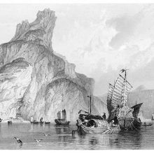 View of the Gulf of Tonkin With boats sailing around a spectacular rock