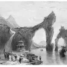 Limestone promontory forming an arch over the water, near Lake Taihu, China