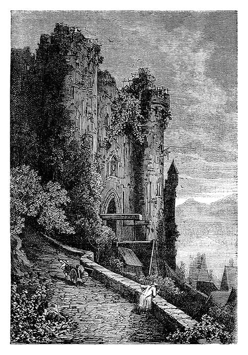View of the façade of a somewhat run-down castle and a side street going up
