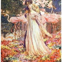 A man embraces the woman standing before him on a riverbank with flamingos in the background