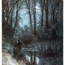 A couple stands on the bank of a stream and looks at the moon through the trees