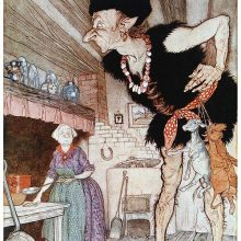 A giant looks inquisitively around a kitchen where a woman is busy cooking