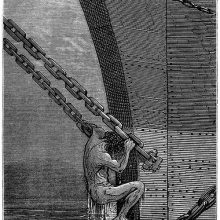 A man pulls himself up from the water using the chains of the ship