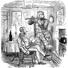 A man stands playing the flute to another sitting in front of a fireplace