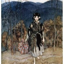 A girl wearing a coat made of cat's hides stands in a landscape of woodland and hills