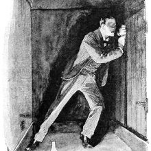 A man is trapped in a lamplit underground room and vainly tries to open the door
