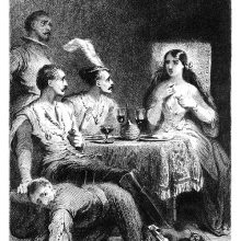 Three men and a woman are sitting at the dinner table as the woman points to herself
