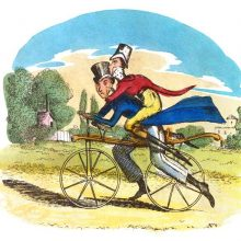 A man rides a dandy-horse on a country road, carrying a second man on his back