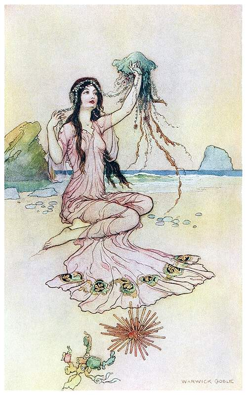 A woman is sitting on a beach holding a jellyfish whose tentacles are made of jewelry