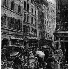 View of a busy street in the rain, with people carrying packages and holding umbrellas
