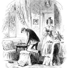 A man with one knee resting on a pouffe leans over a chessboard as a woman enters the room