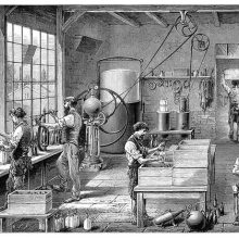 view of a Workshop in a carbonated water factory showing workers filling soda siphons, etc.
