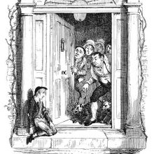 A boy is slumped against a pillar, looking bashfully at the unwelcoming servants at the door