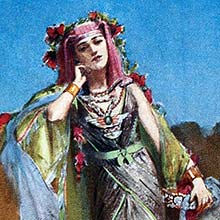 A woman in oriental dress and wreathed in red flowers stands leaning her head on her hand