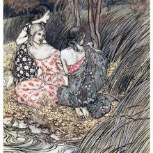 Three young women are sitting on a river bank surrounded by rushes