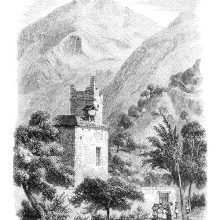 Alpine landscape with mountain peaks, steep slopes, and a building topped with a damaged tower