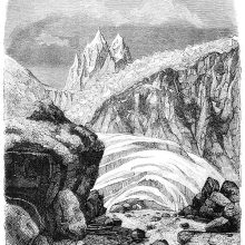 Alpine landscape with rocks, ice sheets, a jagged glacier, and spiky mountain peaks