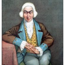Full face portrait of Baron Munchausen sitting on a chair with one elbow resting on a table