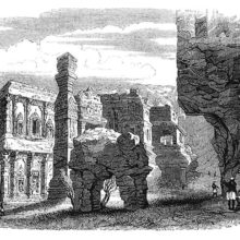 View of the Kailasa temple showing a stone elephant, pillars, and rock-cut architecture