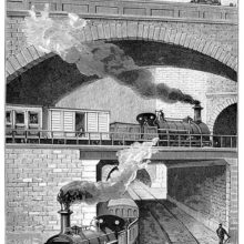 View of a train crossing another over a bridge on the Metropolitan Railway near Clerkenwell Tunnel