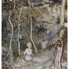 A child stands on a path in the woods looking at a horse as other animals can be seen around