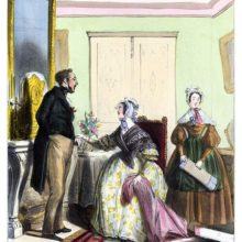 A woman is sitting, a sample of fabric in one hand while tenderly touching her husband's