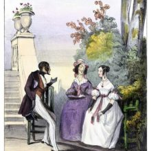 A young man is sitting in a park, conversing with a young woman and her mother