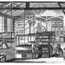 Workshop at the Cusinberche factory, where workers are busy around candle molding machines