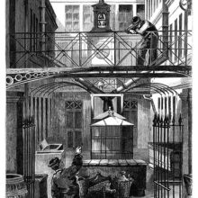 Two men are talking together in a courtyard at the Christofle silver flatware factory