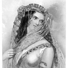 Portrait of Cleopatra wearing a headdress with hanging veils while tilting her head to the right