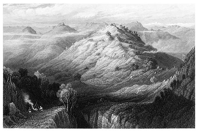 Bird's eye view of a mountainous landscape with a cone-shaped hill standing at its center