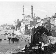 View of the Ganges with the city of Varanasi on its shore, showing domes and minarets