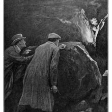 Two men with a gun hide behind a rock as another gazes at them from a similar shelter