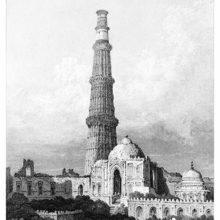 A five-storey minaret rises behind the façade of a run-down mosque, with two men in the foreground